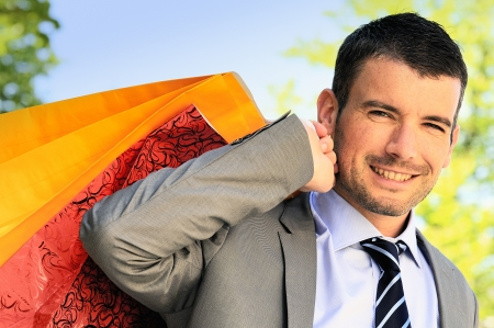 goodie: great businessman outdoor with colored shopping bags
