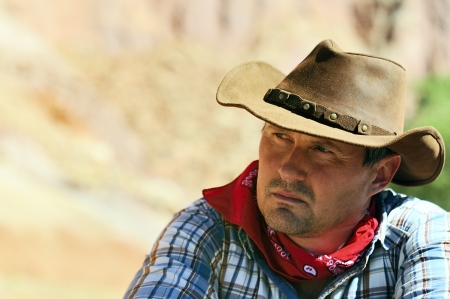 OUT WEST - A cowboy takes time to rest and reflect.  photo