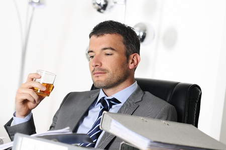 business man is drinking alchool at the office Stock Photo - 16217770