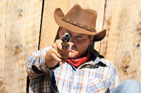 SOUTH WEST - A cowboy is telling you aim with his pistol photo