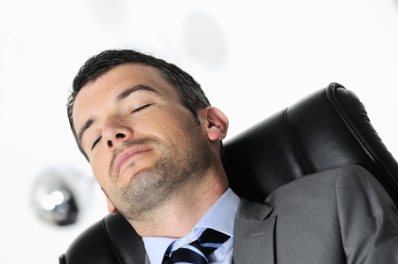Attractive businessman is sleeping a while  from business Stock Photo - 16714316