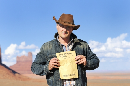 tribal park: attractive cow boy in famous Monument valley National tribal park, USA Stock Photo