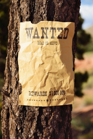 vintage wanted poster in a gost town photo