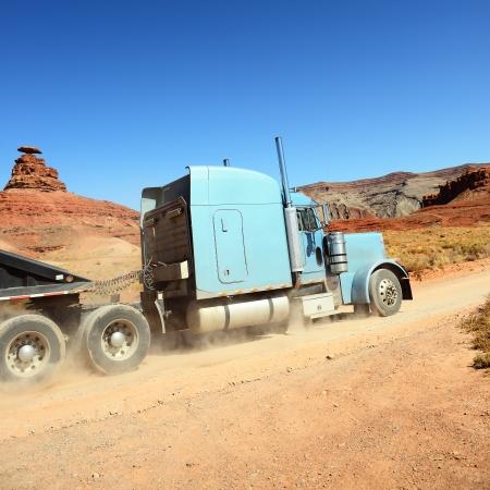 Semi-truck driving across the desert, USA Stock Photo - 17313071