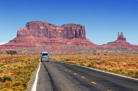 Road leading into Monument Valley  with truck photo