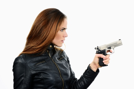 studio shot on white background: young beauty woman holding .44 Magnum handgun, ready to fight  Stock Photo - 17642453