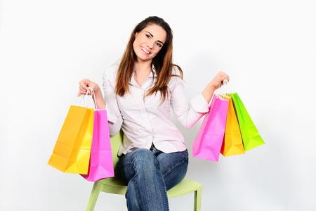 portrait young adult girl with colored bags Stock Photo - 17642456