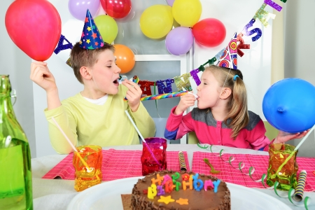 novelties: Happy little children are having fun in a birthday party