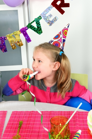 exultation: Happy little girl how have fun in a birthday party