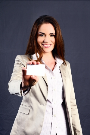 buisiness: executive and attractive caucasian woman with a buisiness card Stock Photo