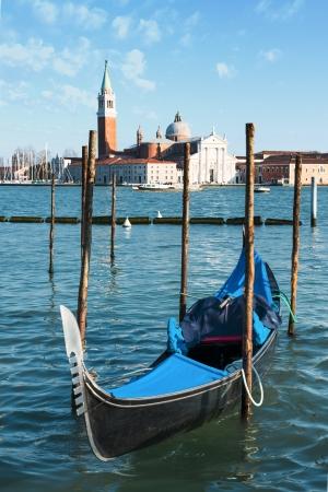 Gondolas moored by Saint Mark square with San Giorgio di Maggiore church in the background - Venice, Venezia, Italy, Europe  Stock Photo - 18988244