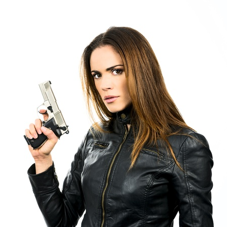 studio shot on white background: young beauty woman holding .44 Magnum handgun, ready to fight  photo