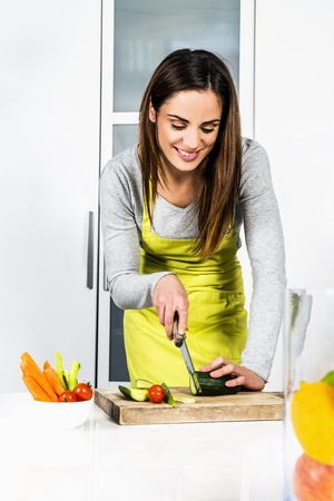 woman knife: Young Woman Cooking. Healthy Food - Vegetable Salad. Diet. Dieting Concept. Healthy Lifestyle. Cooking At Home. Prepare Food