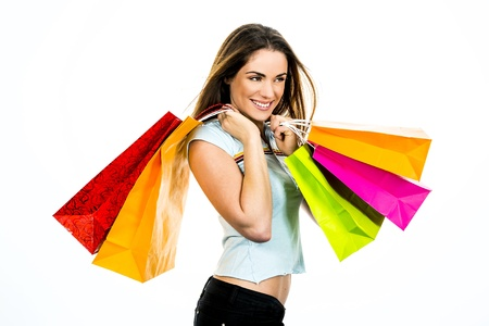 euphoria: portrait young adult girl with colored bags Stock Photo