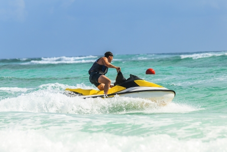 Man on Wave Runner turns fast on the water photo