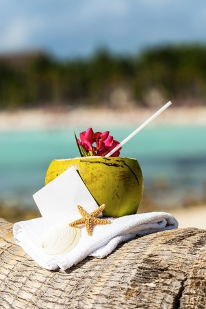 caribbean drink: Coconut cocktail starfish tropical Caribbean beach refreshment and towel