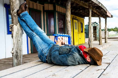 cowboy: SOUTH WEST - A cowboy takes time to rest and reflect.