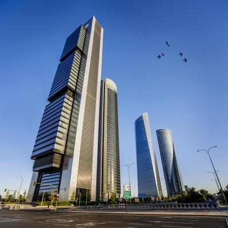 cuatro: four modern skyscrapers (Cuatro Torres) Madrid, Spain  Stock Photo