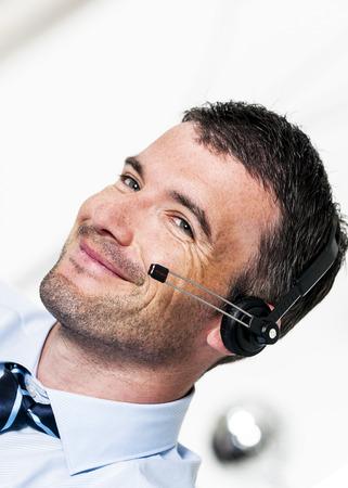 beautiful man is calling by headphone photo