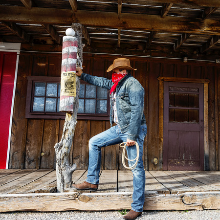 bandana western: SOUTH WEST - A cowboy takes time to rest and reflect  Stock Photo