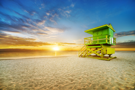 lifeguard tower: Miami South Beach sunrise with lifeguard tower and coastline with colorful cloud and blue sky