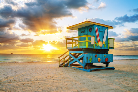 lifeguard tower: Miami South Beach sunrise with lifeguard tower and coastline with colorful cloud and blue sky.
