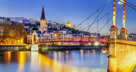 rhone: night view from St Georges footbridge in Lyon city with Fourviere cathedral, France