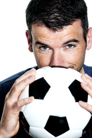 closeup of passionate soccer player with white and black balloon photo