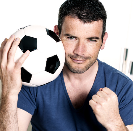 closeup of passionate soccer player with white and black balloon Standard-Bild