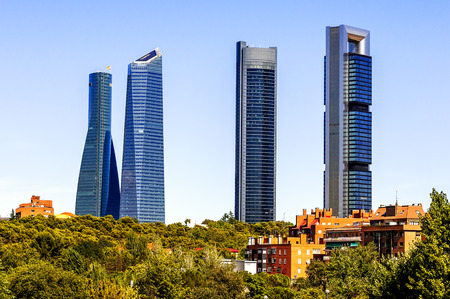 torres: four modern skyscrapers  Cuatro Torres  Madrid, Spain  Stock Photo