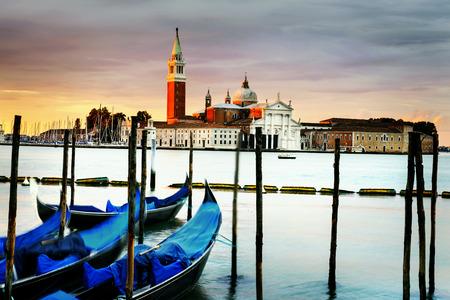 saint mark square: Gondolas moored by Saint Mark square with San Giorgio di Maggiore church in Venice, Venezia, Italy Stock Photo