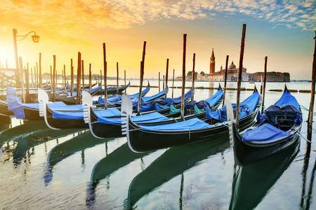 italy background: Gondolas moored by Saint Mark square with San Giorgio di Maggiore church in the background - Venice, Venezia, Italy, Europe