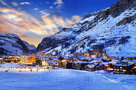 Famous and luxury place of Val dIsere at sunset, Tarentaise, Alps, France Stock Photo