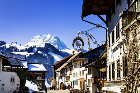 swiss culture: GRUYERES, SWITZERLAND - MARCH 03, 2015: View of the main street in the swiss village Gruyeres, Switzerland . The town and region are famous for their Swiss Cheese called Gruyere.