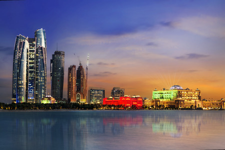 exterior architecture: Panorama of Abu Dhabi at night, capital of United Arab Emirates