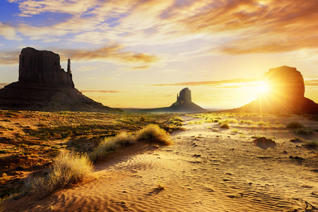 desert storm: Sunrise at the sisters in Monument Valley, USA