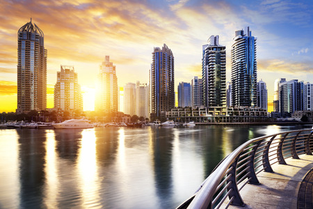 skyline of Dubai Marina with boats at night United Arab Emirates Middle East Stock Photo