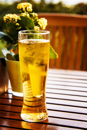 un bottled: glass of fresh beer on a table in a restaurant