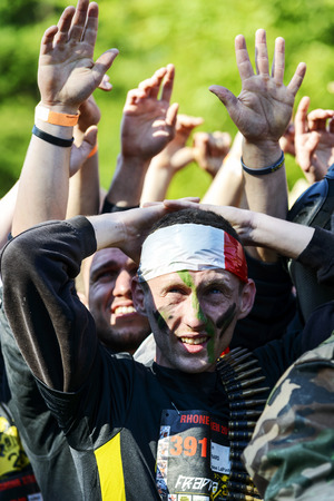 commando: LYON, FRANCE - MAY 24: A man dressed in military commando,  Frappadingue race participating in the event in the Miribel Jonage Park to Lyon on May 25, 2015. People from all walks of life participated in the run. Editorial