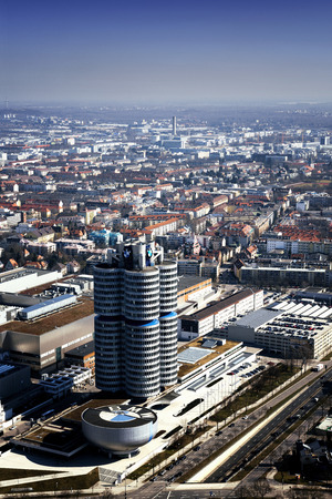 automaker: MUNICH, GERMANY - JANUARY 5: BMW Headquarters on March 10, 2015. The four vertical cylinders building is a Munich landmark which is world headquarters for the Bavarian automaker.