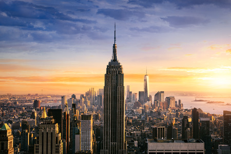 New York City skyline with urban skyscrapers at sunset, USA. Редакционное