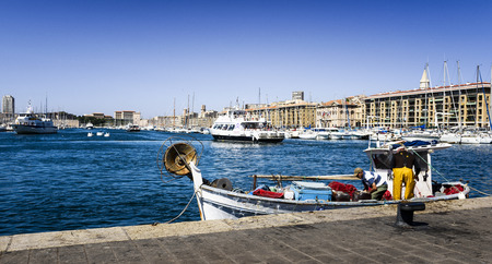 fishermans net: MARSEILLE - AUGUST 19 :Fishermans on a traditional boat at the famous old port on August 19 2015 in Marseille,France.Marseille is Frances largest city on the Mediterranean coast and largest commercial port.