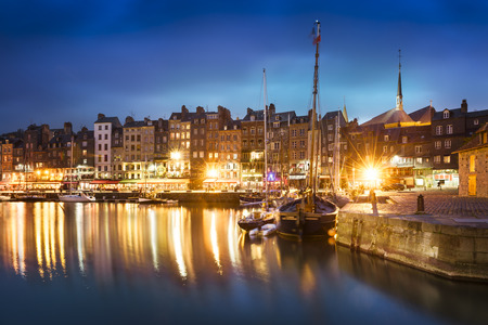boat house: Nightscape of the old harbor in Honfleur, France (02) Stock Photo