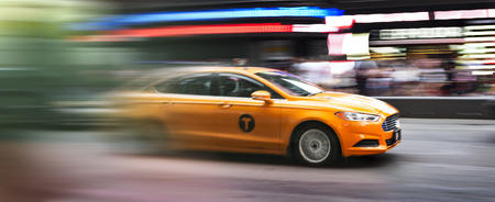 times square new york: speedy taxi in Times square New York city, USA Stock Photo