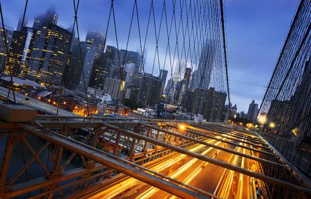 brooklyn bridge: New York City - beautiful sunrise over manhattan with manhattan and brooklyn bridge USA