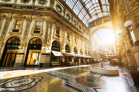 prada: MILAN, ITALY - AUGUST 29, 2015: Luxury Store in Galleria Vittorio Emanuele II shopping mall in Milan, with shoppers and tourists strolling around. Prada is an Italian luxury fashion house founded in 1913 Editorial