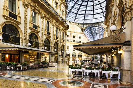 MILAN, ITALY - AUGUST 29, 2015: Luxury Store in Galleria Vittorio Emanuele II shopping mall in Milan, with tasted Italian restaurants Editorial