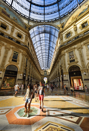 ii: MILAN, ITALY - AUGUST 29, 2015: Luxury Store in Galleria Vittorio Emanuele II shopping mall in Milan, with tasted Italian restaurants Editorial