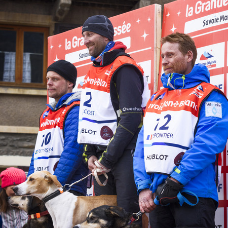 huskys: TERMIGNON, VANOISE, FRANCE - JANUARY 20 2016 - The podium Remy COSTE the winner of the GRANDE ODYSSEE the hardest mushers race, the 2nd Jimmy PETTERSSON and 3th named Jean-Philippe PONTHIER, Vanoise, Alps