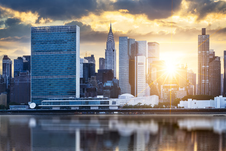 exterior architecture: New York City skyline with urban skyscrapers at sunset, USA. Stock Photo